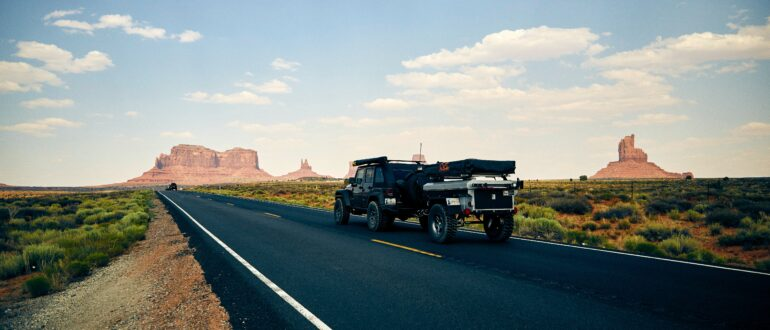 Car towing camper trailer